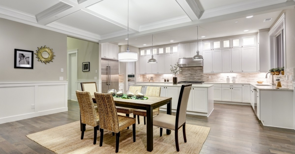 An eloquently staged dining and kitchen area.
